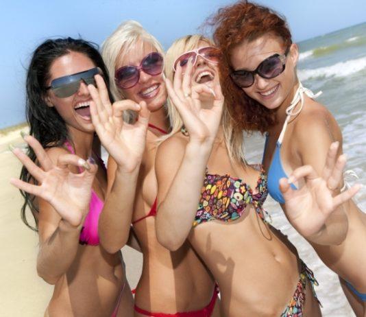 Ladies on the beach enjoying the sun